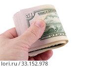 Пачка 50-ти долларовых купюр в руке, изолировано на белом фоне. Стоковое фото, фотограф Игорь Долгов / Фотобанк Лори