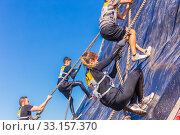 Купить «Russia, Samara, June 2019: Young beautiful girl overcomes the most difficult obstacle in the race of heroes of Everest with the help of a rope», фото № 33157370, снято 8 июня 2019 г. (c) Акиньшин Владимир / Фотобанк Лори