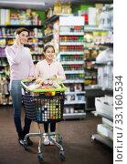 Купить «Woman with girl telephoning to consult about shopping», фото № 33160534, снято 5 января 2017 г. (c) Яков Филимонов / Фотобанк Лори