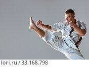 Купить «Man in white kimono training karate», фото № 33168798, снято 11 июля 2020 г. (c) PantherMedia / Фотобанк Лори