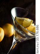 Купить «Lemon slices in martini glass», фото № 33176686, снято 31 марта 2020 г. (c) PantherMedia / Фотобанк Лори