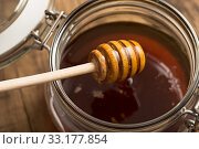 Купить «liquid honey with glass and spoon», фото № 33177854, снято 5 июля 2020 г. (c) PantherMedia / Фотобанк Лори