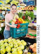 Купить «Woman with basket with fruits and vegetables», фото № 33180662, снято 14 октября 2017 г. (c) Яков Филимонов / Фотобанк Лори