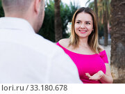 Купить «Young female is flirting with guy», фото № 33180678, снято 18 октября 2017 г. (c) Яков Филимонов / Фотобанк Лори