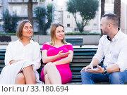 Купить «Guy is talking with smiling stranger women who are sitting on the bench», фото № 33180694, снято 18 октября 2017 г. (c) Яков Филимонов / Фотобанк Лори