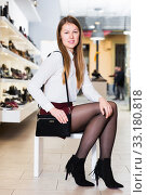 Young woman is posing with new handbag and fashion footwear. Стоковое фото, фотограф Яков Филимонов / Фотобанк Лори