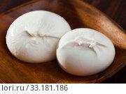 Купить «Italian cheese burrata on wooden plate», фото № 33181186, снято 24 февраля 2020 г. (c) Яков Филимонов / Фотобанк Лори