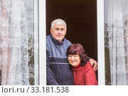 Купить «beautiful elderly couple looks out the window of a country house.», фото № 33181538, снято 29 сентября 2019 г. (c) Акиньшин Владимир / Фотобанк Лори