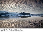 Купить «Reflections in Fjallsarlon lagoon in Iceland,  by sunset», фото № 33189550, снято 23 февраля 2020 г. (c) PantherMedia / Фотобанк Лори