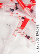 small syringes with hypodermic needles and caps drug diabetes. Стоковое фото, фотограф Nils Weymann / PantherMedia / Фотобанк Лори