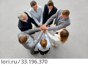 happy business people stacking hands. Стоковое фото, фотограф Syda Productions / Фотобанк Лори