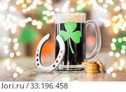 shamrock on glass of beer, horseshoe and coins. Стоковое фото, фотограф Syda Productions / Фотобанк Лори