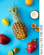 Купить «pineapple with other fruits on blue background», фото № 33196558, снято 16 ноября 2018 г. (c) Syda Productions / Фотобанк Лори