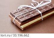 Купить «different kinds of chocolate on brown background», фото № 33196662, снято 1 февраля 2019 г. (c) Syda Productions / Фотобанк Лори