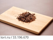 Купить «chocolate chips on wooden board», фото № 33196670, снято 1 февраля 2019 г. (c) Syda Productions / Фотобанк Лори