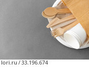 Купить «wooden spoons, forks and knives on paper plate», фото № 33196674, снято 3 мая 2019 г. (c) Syda Productions / Фотобанк Лори