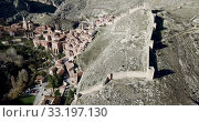 Купить «Defensive Northern wall of Albarracin on background of cityscape with Cathedral tower, Aragon, Spain», видеоролик № 33197130, снято 26 декабря 2018 г. (c) Яков Филимонов / Фотобанк Лори