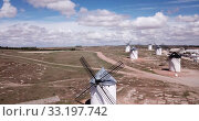 Купить «Picturesque view of windmills in Campo de Criptana municipality, Spain», видеоролик № 33197742, снято 23 апреля 2019 г. (c) Яков Филимонов / Фотобанк Лори