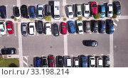 Купить «Top view of wide road with markings and lots of cars at day», видеоролик № 33198214, снято 20 июня 2019 г. (c) Яков Филимонов / Фотобанк Лори
