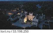 Купить «Evening aerial view on the medieval castle Lednice. South Moravian region. Czech Republic», видеоролик № 33198250, снято 10 апреля 2020 г. (c) Яков Филимонов / Фотобанк Лори