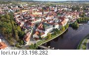 Купить «Panoramic view from the drone on the city Pisek. Czech Republic», видеоролик № 33198282, снято 11 октября 2019 г. (c) Яков Филимонов / Фотобанк Лори