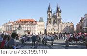 Купить «Prague, Czech - October 13, 2019: Old Town Square on bright autumn day. Prague. Czech Republic», видеоролик № 33199110, снято 13 октября 2019 г. (c) Яков Филимонов / Фотобанк Лори