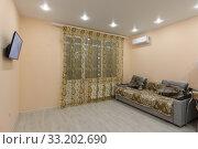 Купить «The interior of a spacious room with modest furniture», фото № 33202690, снято 20 февраля 2020 г. (c) Иванов Алексей / Фотобанк Лори