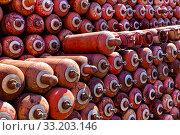 Купить «Баллоны с опасным сжиженным газом», фото № 33203146, снято 19 апреля 2019 г. (c) Евгений Ткачёв / Фотобанк Лори