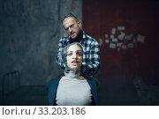 Купить «Maniac kidnapper smothers his scared female victim», фото № 33203186, снято 13 ноября 2019 г. (c) Tryapitsyn Sergiy / Фотобанк Лори
