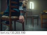 Купить «Female victim of maniac kidnapper with taped hands», фото № 33203190, снято 13 ноября 2019 г. (c) Tryapitsyn Sergiy / Фотобанк Лори