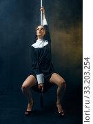 Купить «Sexy perverse nun in a cassock dances on a pole», фото № 33203254, снято 14 ноября 2019 г. (c) Tryapitsyn Sergiy / Фотобанк Лори