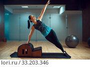 Купить «Slim girl on pilates training in gym, flexibility», фото № 33203346, снято 26 ноября 2019 г. (c) Tryapitsyn Sergiy / Фотобанк Лори