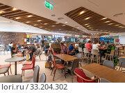 Купить «Larnaca, Cyprus - November 12. 2019. food court area at international airport», фото № 33204302, снято 12 октября 2019 г. (c) Володина Ольга / Фотобанк Лори