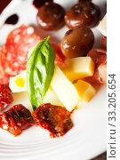 italian antipasti on a plate. Стоковое фото, фотограф Bernd Jürgens / PantherMedia / Фотобанк Лори