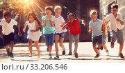 Купить «Group of joyful children running down the city street», фото № 33206546, снято 8 апреля 2020 г. (c) Яков Филимонов / Фотобанк Лори