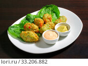 Plate with vegetable cutlets on lettuce and sauce. Стоковое фото, фотограф Алексей Хромушин / Фотобанк Лори