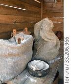 Купить «Sacks of flour on wooden bench in barn», фото № 33206966, снято 22 февраля 2020 г. (c) Валерия Попова / Фотобанк Лори