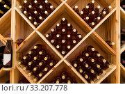 Купить «Stacked bottles of grape wine in a wine cellar», фото № 33207778, снято 9 июня 2018 г. (c) Наталья Волкова / Фотобанк Лори