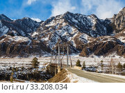 Suspension road bridge over Katun in the Chemalsky district of the Altai Republic in winter. Russia. Стоковое фото, фотограф Наталья Волкова / Фотобанк Лори