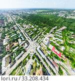 Купить «Aerial city view with crossroads and roads, houses, buildings, parks and parking lots. Sunny summer panoramic image», фото № 33208434, снято 29 марта 2020 г. (c) Александр Маркин / Фотобанк Лори