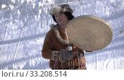 Male dancing with tambourine in national winter clothing native people (2020 год). Редакционное видео, видеограф А. А. Пирагис / Фотобанк Лори