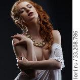 Купить «Sensuality and luxury. Red-haired model posing», фото № 33208786, снято 20 июня 2016 г. (c) Гурьянов Андрей / Фотобанк Лори