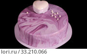 Handmade birthday cake with a sweet heart rotates on a black background. Стоковое видео, видеограф Алексей Кузнецов / Фотобанк Лори