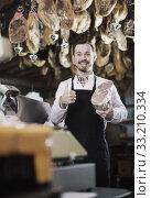 Seller offering piece of meat. Стоковое фото, фотограф Яков Филимонов / Фотобанк Лори