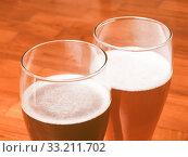 Retro looking Two glasses of German beer. Стоковое фото, фотограф Claudio Divizia / PantherMedia / Фотобанк Лори