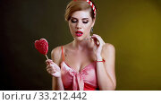 Woman lick lollipop and dance has flirting behavior. Стоковое видео, видеограф Gennadiy Poznyakov / Фотобанк Лори