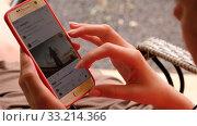 Купить «From above closeup of crop of faceless female browsing social media on smartphone while resting in cafe», видеоролик № 33214366, снято 21 февраля 2020 г. (c) Ekaterina Demidova / Фотобанк Лори