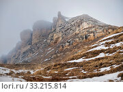 Majestic rocks of the Caucasus in foggy clouds with snow at the foot in perspektive. Стоковое фото, фотограф Zoonar.com/Ian Iankovskii / easy Fotostock / Фотобанк Лори