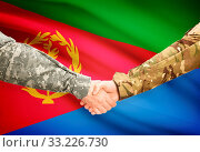 Купить «Soldiers shaking hands with flag on background - Eritrea», фото № 33226730, снято 14 июля 2020 г. (c) age Fotostock / Фотобанк Лори