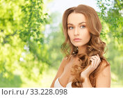 Купить «beautiful woman with curly hair», фото № 33228098, снято 10 октября 2010 г. (c) Syda Productions / Фотобанк Лори